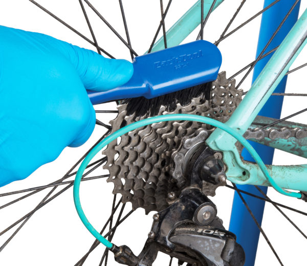 The Park Tool GSC-4 Bicycle Cassette Cleaning Brush cleaning cassette cogs, click to enlarge