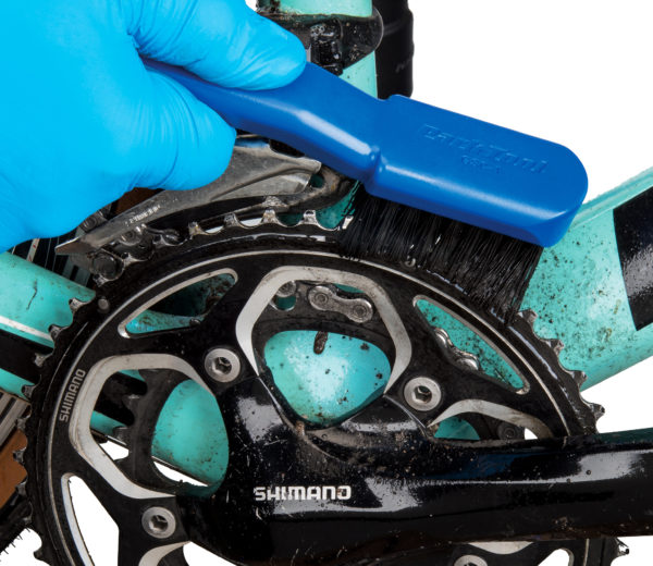 The Park Tool GSC-4 Bicycle Cassette Cleaning Brush cleaning front chainring, click to enlarge