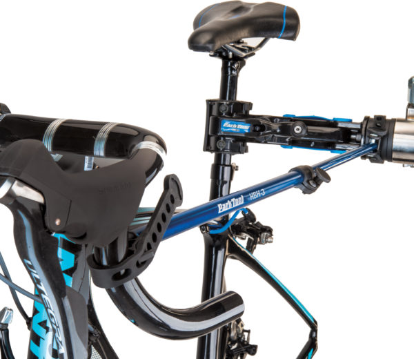 The Park Tool HBH-3 Extendable Handlebar Holder holding drop handlebars on bike in repair stand, click to enlarge