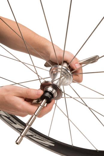 The Park Tool HBP-1 Hub Bearing Press Set installing bearings inside road bike hub, click to enlarge