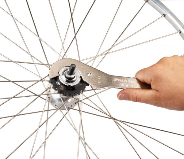 Park Tool HCW-17 Fixed-Gear Lockring Wrench removing a lockring from a fixed-gear hub, click to enlarge