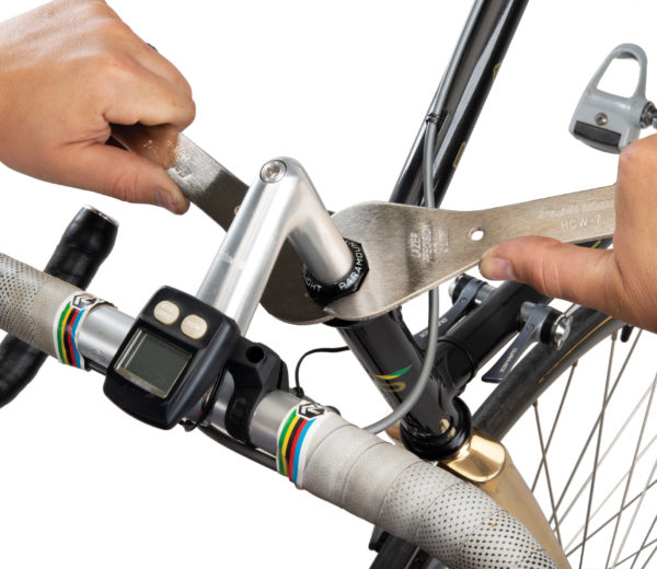 Securing a threaded headset using Park Tool HCW-6 and HCW-7 Headset Wrenches, click to enlarge