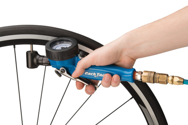 The Park Tool INF-2 Shop Inflator inflating road tire with Presta valve, click to enlarge