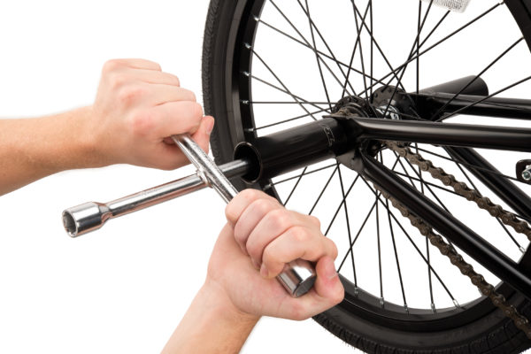 The Park Tool MQ-1 Metric Quad Wrench removing axle nuts from BMX bike with pegs, click to enlarge
