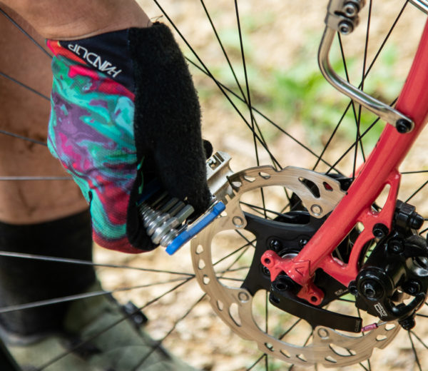 The Park Tool MTB-5 Rescue Tool being used to straighten a mountain bike disc brake rotor, click to enlarge