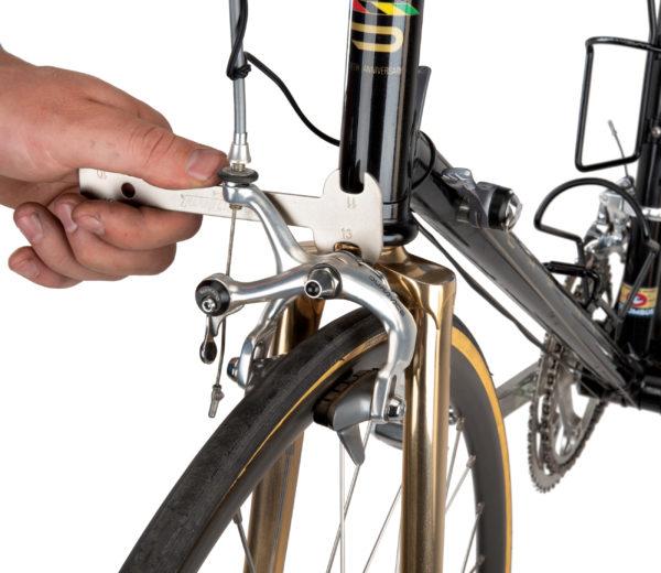 The Park Tool OBW-4 Offset Brake Wrench adjusting center ring on dual pivot brake, click to enlarge