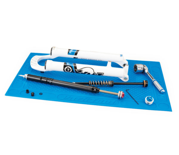 tools and bike parts placed on a blue textured OM-2 Benchtop Overhaul Mat, click to enlarge