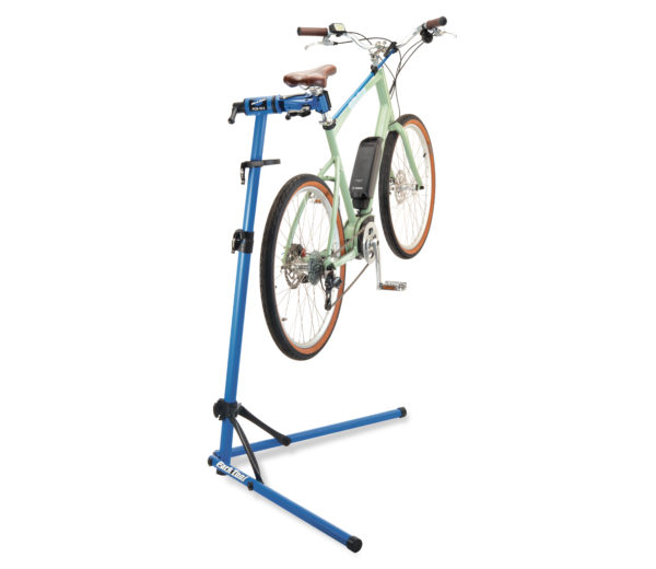 The Park Tool PCS-10.3 Deluxe Home Mechanic Repair Stand holding an e-bike, click to enlarge