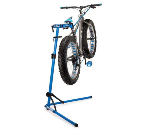 The Park Tool PCS-10.3 Deluxe Home Mechanic Repair Stand holding a fat bike, click to enlarge