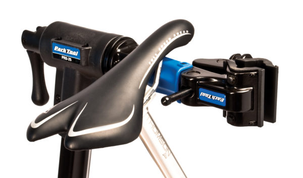 Close-up of the Park Tool PRS-25 Team Issue Repair Stand clamp with bike seat balancing on arm, click to enlarge