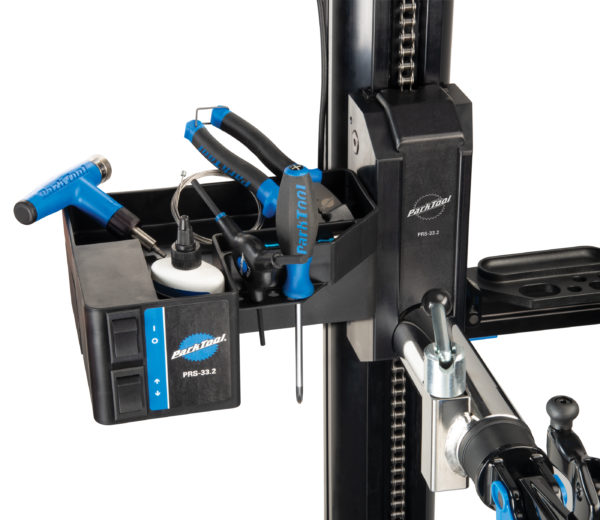 Close-up of tools in the Park Tool PRS-33.2 Power Lift Shop Stand tool tray and power lift, click to enlarge