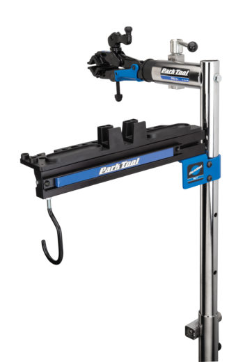 An empty Park Tool PRS-TT Deluxe Tool and Work Tray on top of a single arm Park Tool repair stand, click to enlarge