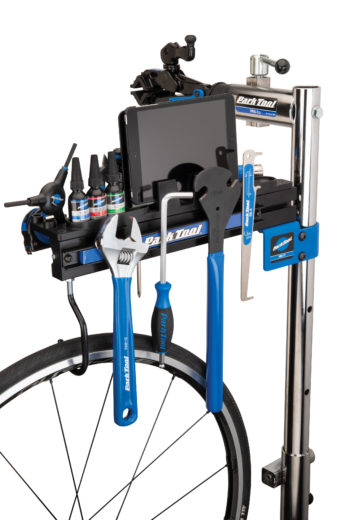 Park Tool PRS-TT Deluxe Tool and Work Tray on top of a Park Tool repair stand filled with tools and an Ipad, click to enlarge