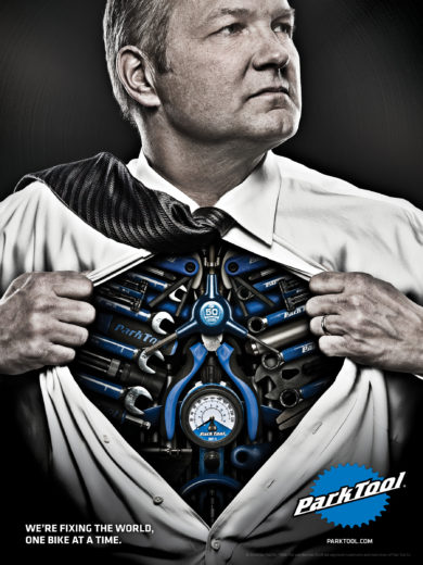 Park Tool advertisement man in super man pose exposing chest of bike tools, click to enlarge