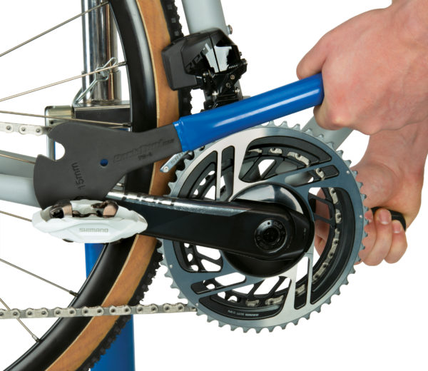 The Park Tool PW-4 Professional Pedal Wrench removing a road bike pedal, click to enlarge