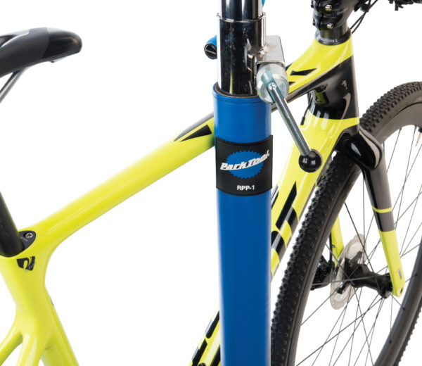 Park Tool RPP-1 Repair Stand Post Protector mounted to shop repair stand with yellow bike leaning on it, click to enlarge