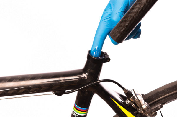 The Park Tool SAC-2 SuperGrip™ Carbon and Alloy Assembly Compound being applied to seat tube using gloved hand, click to enlarge