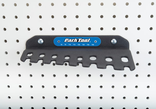 Park Tool THT-1 Sliding T-Handle Torx Compatible Wrench holder hanging on a pegboard, click to enlarge