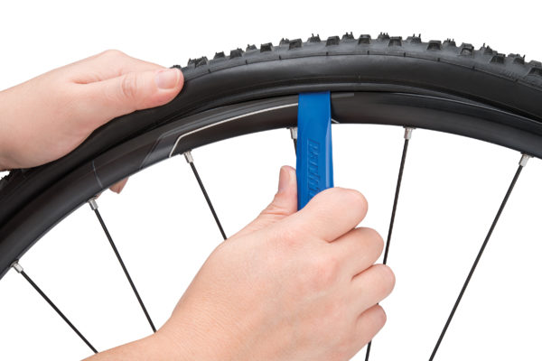 The Park Tool TL-6.2 Steel Core Tire Lever removing mountain bike tire, click to enlarge
