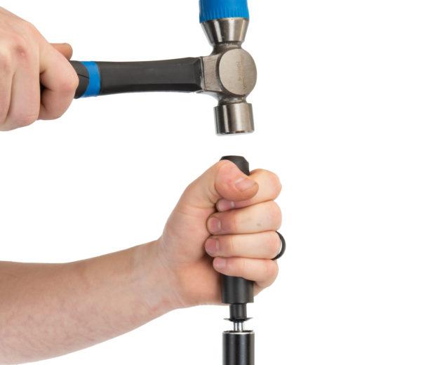 The Park Tool TNS-1 Threadless Nut Setter installing star-fangled nut into fork steerer tube, click to enlarge