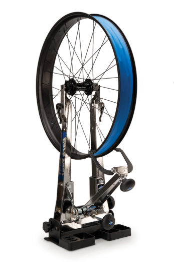 Park Tool TS-2EXT.2 Truing Stand Extensions / Adaptors holding disc brake wheel, click to enlarge