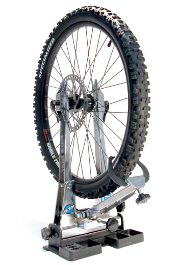 Park Tool TS-2EXT Truing Stand Extensions / Adaptors holding mountain bike disc brake wheel, click to enlarge