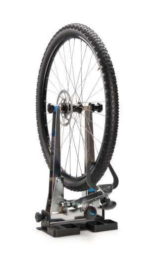 Park Tool TS-TA Thru Axle Adaptor holding a mountain bike wheel in a TS-2.2 Professional Wheel Truing Stand, click to enlarge