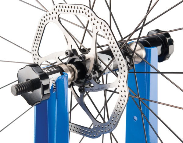 Close-up of Park Tool TS-TA Thru Axle Adaptor holding a bike wheel in TS-2.2P Professional Wheel Truing Stand, click to enlarge