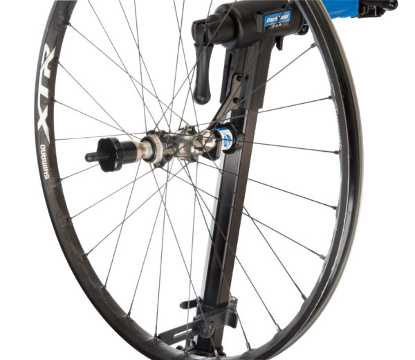 Park Tool TS-TA Thru Axle Adaptor holding a bike wheel in a TS-25 Repair Stand Mounted Wheel Truing Stand, click to enlarge