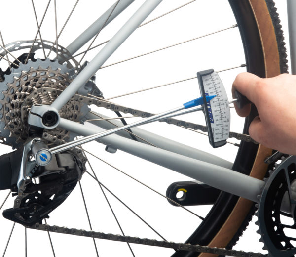 The Park Tool TW-1.2 Beam-Type Torque Wrench torquing a rear derailleur hanger bolt on a gravel bike, click to enlarge