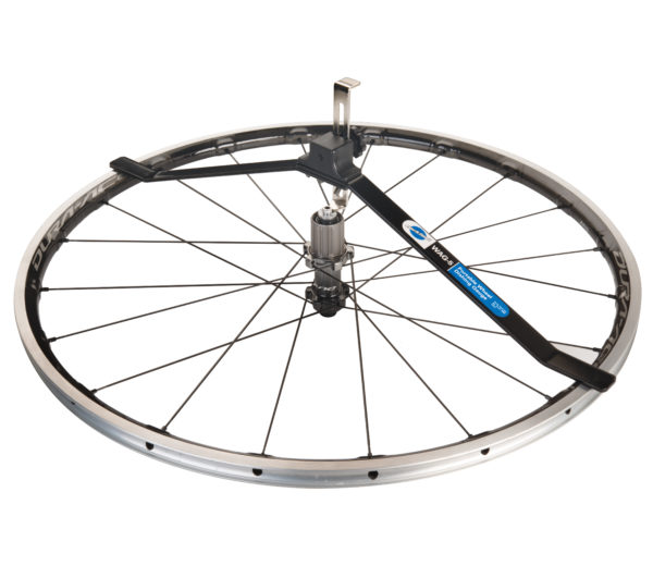The Park Tool WAG-5 Wheel Alignment Gauge measuring dish on a rear road bike wheel, click to enlarge