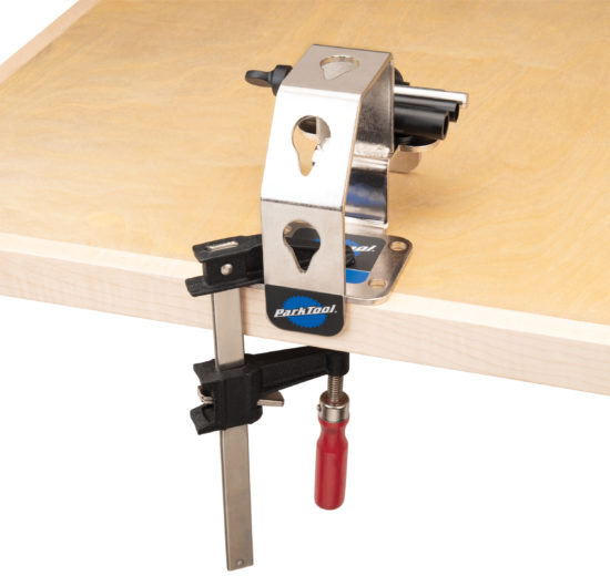Park Tool WH-1 Wheel Holder temporarily installed on workbench with C-clamp, click to enlarge