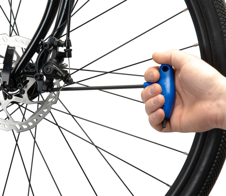 PH-5 5 mm hex wrench tightening a disc brake mount bolt, enlarged