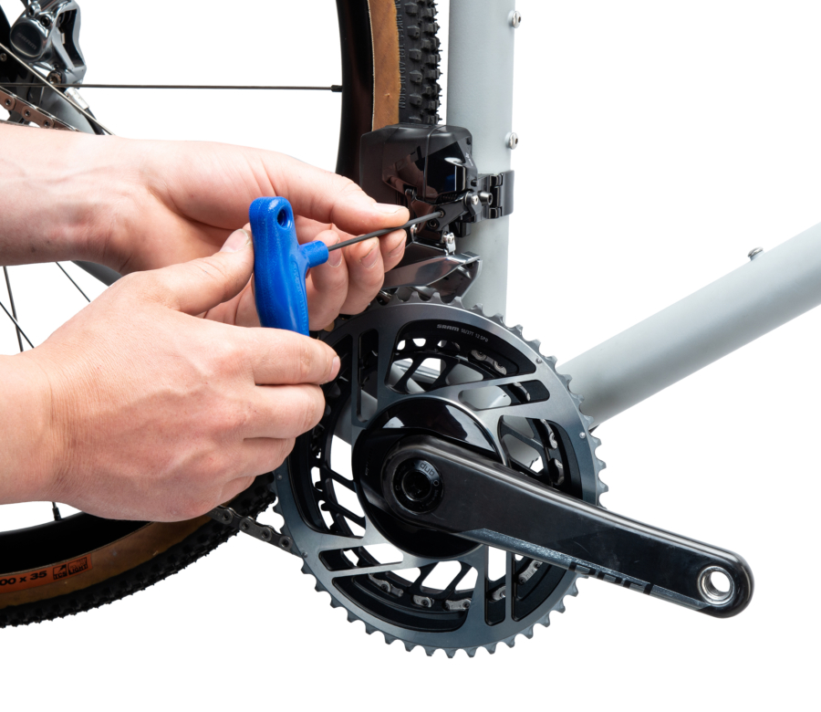 PH-25 2.5 mm wrench adjusting a front derailleur limit screw, enlarged