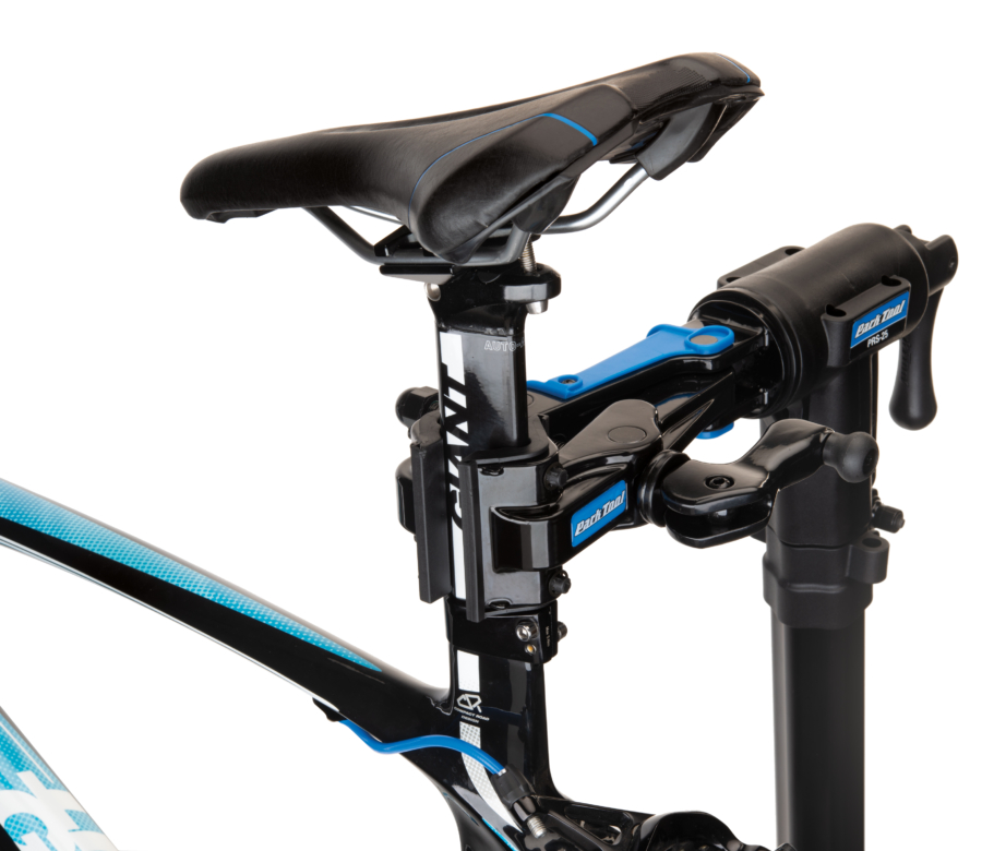The Park Tool 100-25D Professional Micro-Adjust Clamp attached to repair stand holding aero bike seat post, enlarged