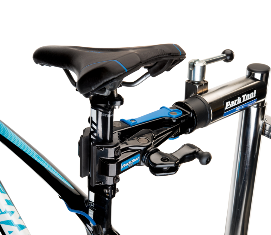 The Park Tool 100-3D Professional Micro-Adjust Clamp attached to stand holding aero bike seat post, enlarged