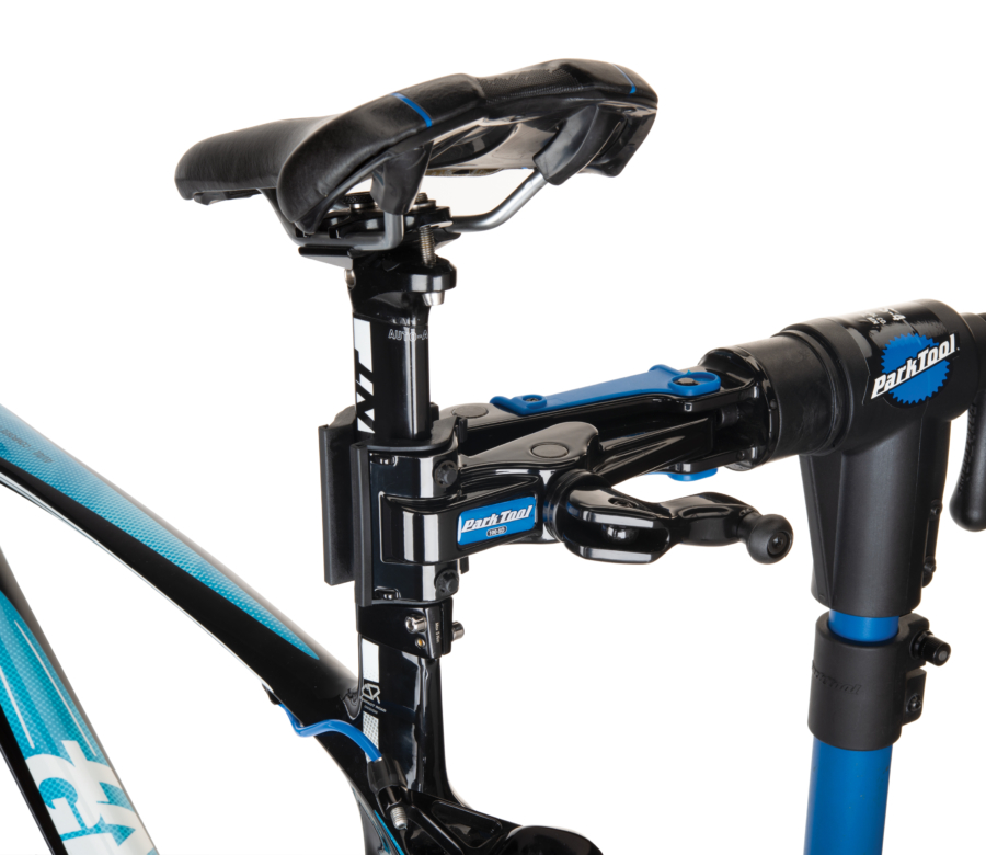 The Park Tool 100-5D Professional Micro-Adjust Clamp attached to repair stand holding aero bike seat post, enlarged