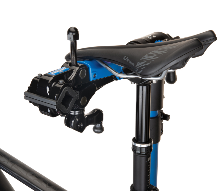 The Park Tool 100-5D Professional Micro-Adjust Clamp attached to stand with saddle resting on saddle cradle, enlarged
