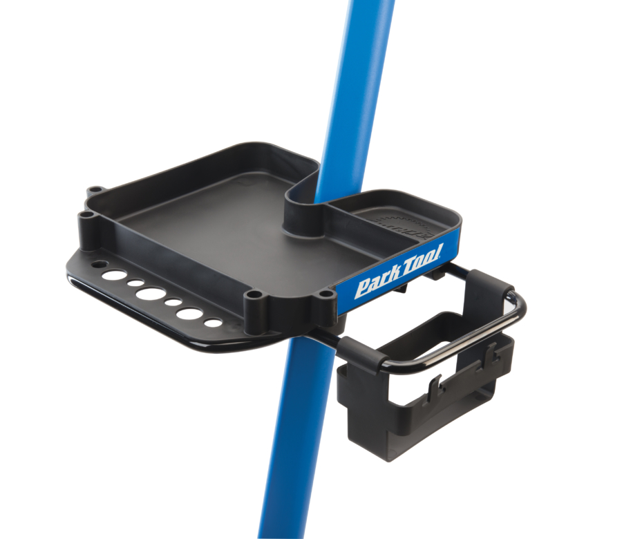 An empty Park Tool 106 Work Tray attached to a Park Tool Repair Stand, enlarged