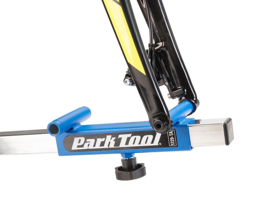 Front 12mm thru axle bike installed on the Park Tool 1749-TA Sliding Thru Axle Adaptor, enlarged