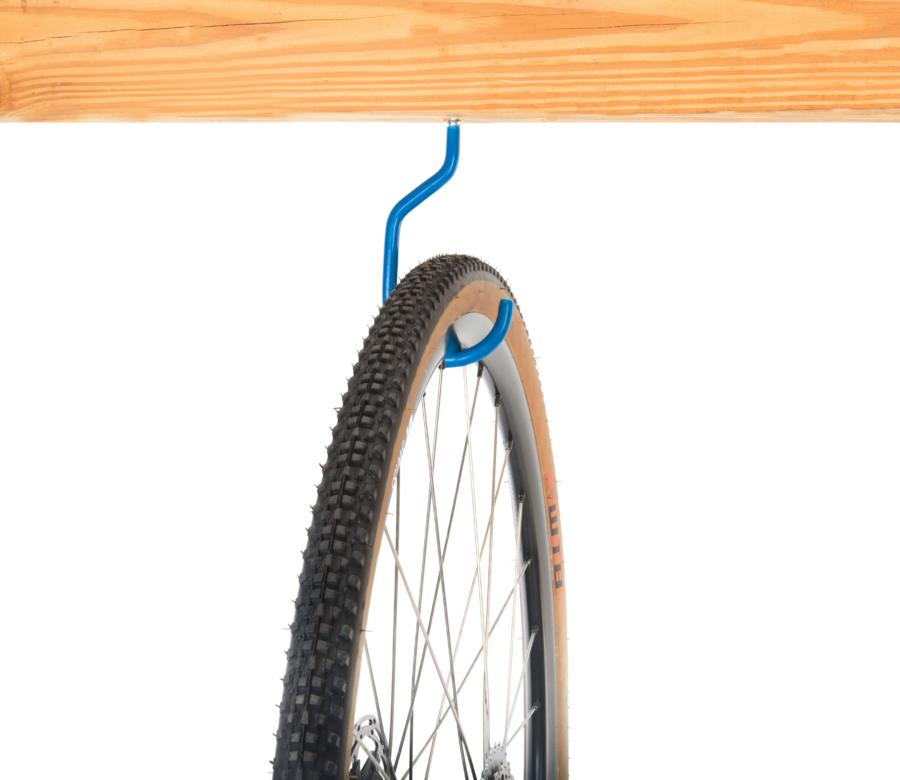 Park Tool 451 Wood Thread Storage Hook mounted to wooden plank holding road bike wheel, enlarged
