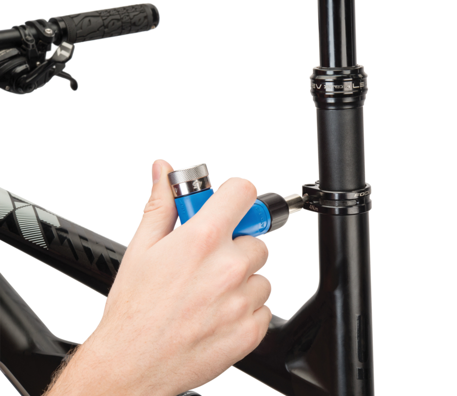 The Park Tool ATD-1.2 Adjustable Torque Driver torqueing seat post clamp, enlarged