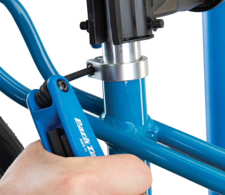 Park Tool AWS-11 Fold-Up Hex Wrench Set tightening a seat post clamp, enlarged