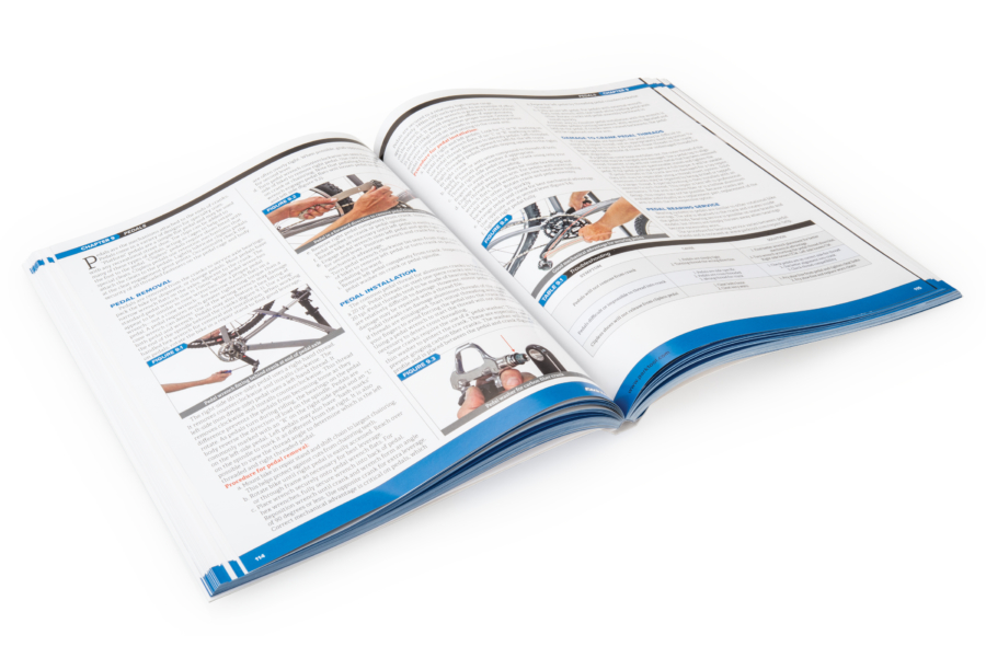 The Park Tool BBB-4 Big Blue Book of Bicycle Repair — 4th Edition open to a middle page, enlarged
