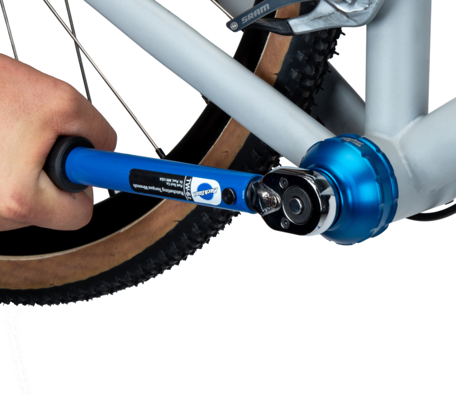 The Park Tool BBT-47-12 Bottom Bracket Tool being driven by a TW-6.2 torque wrench to secure a bottom bracket, enlarged