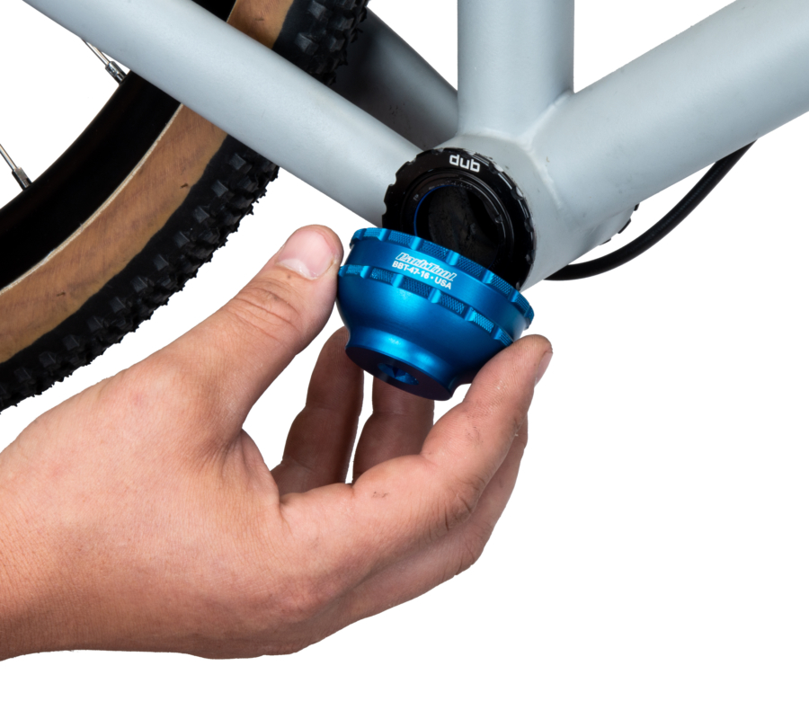 The Park Tool BBT-47-16 Bottom Bracket Tool being installed onto a gravel bike bottom bracket cup, enlarged