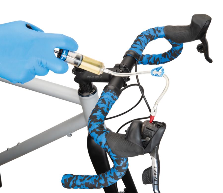 Park Tool Bleed Kit syringe hooked up to drop bar SRAM® lever, enlarged