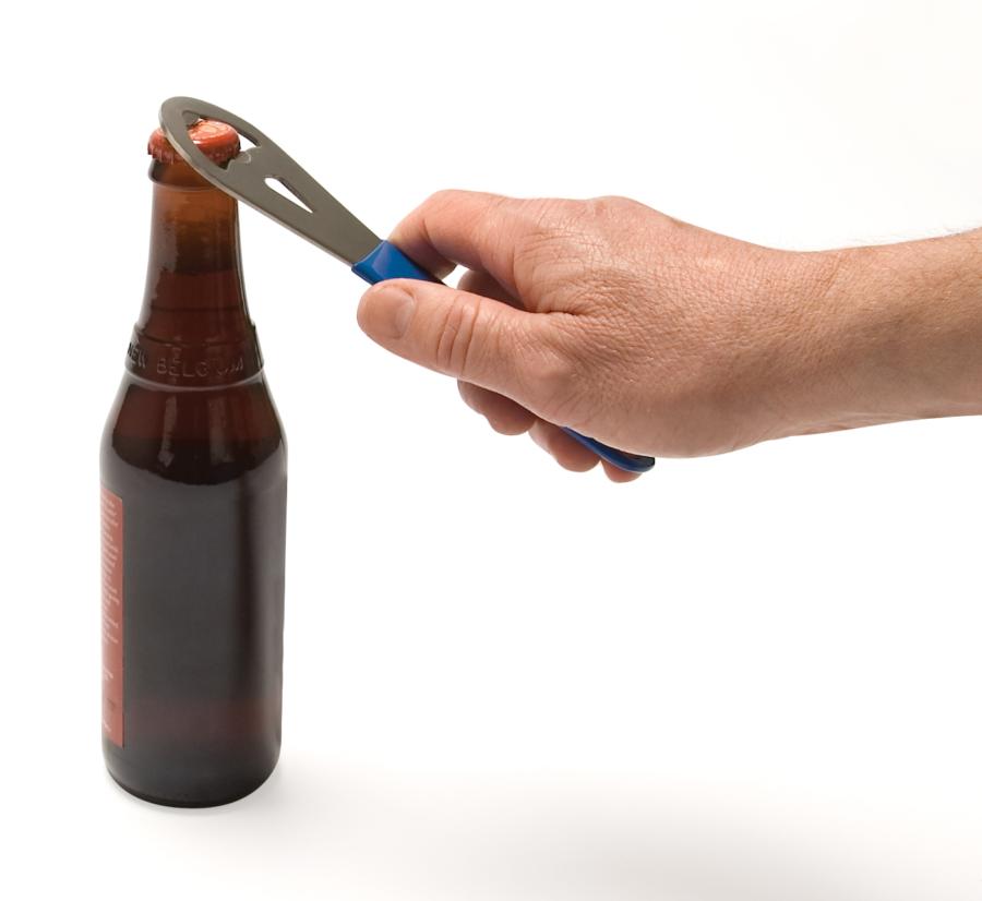 The Park Tool BO-2 Bottle Opener opening bottle, enlarged
