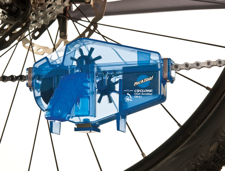 The Park Tool CM-5.2 Cyclone™ Chain Scrubber installed on bicycle chain, enlarged