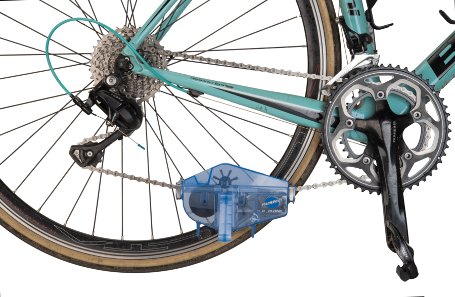 Park Tool CM-5.3 Cyclone™ Chain Scrubber installed on bicycle chain, enlarged